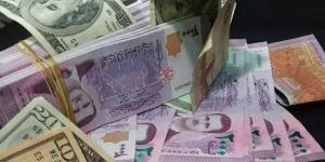 مصرف سوريا المركزي يرفع سعر الدولار بنسبة 100%